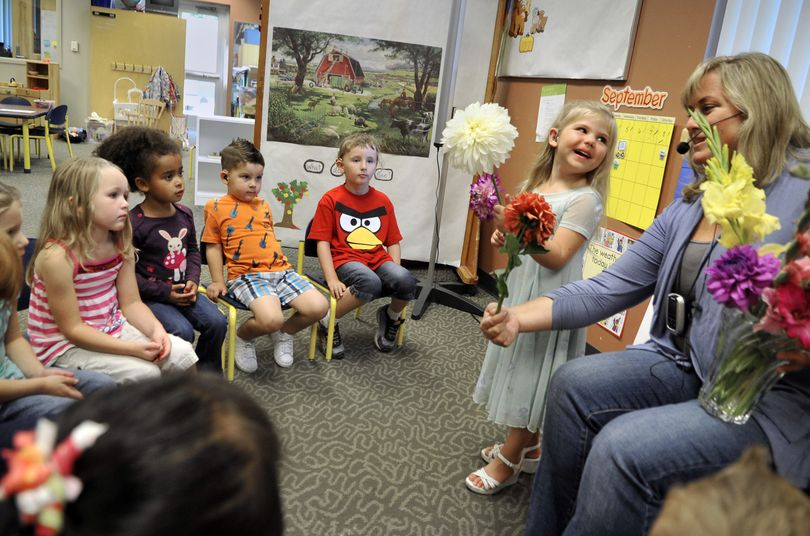 Payton Miller shows teacher Amy Hardie and her classmates the flowers she brought to the HOPE School on Sept. 13 on the Riverpoint Campus in Spokane. (Dan Pelle)