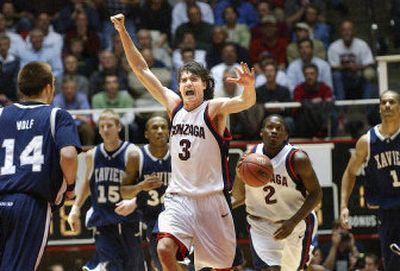 Adam Morrison, celebrating a defensive stand, leads the charge in Thursday night's first-round victory over the Musketeers. Morrison scored 35 points and also led the team in assists with four.