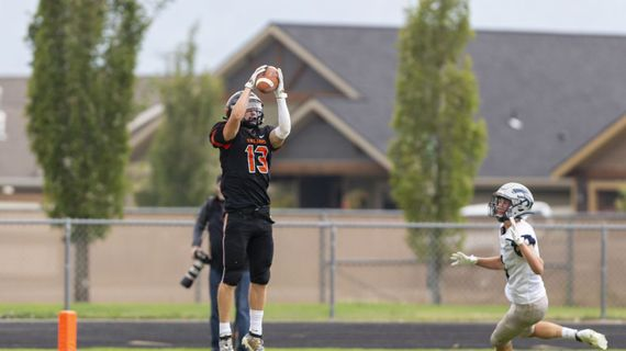 Post Falls receiver Tommy Hauser gathers his second touchdown catch of the game as the Trojans came from behind to beat visiting Lake City 34-13 in a nonleague game between league rivals on Saturday, Sept. 19, 2020.  (Cheryl Nichols/courtesy)