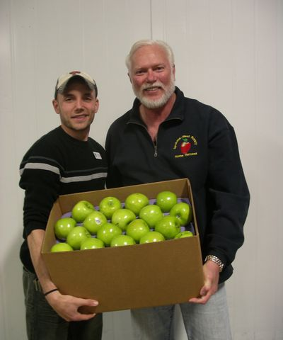 Second Harvest coordinator Keith Burgeson, left, and Bob Slyter, of Spokane Rotary West, hope apples from backyard fruit trees will fill food banks later in the summer. (PAT MUNTS)