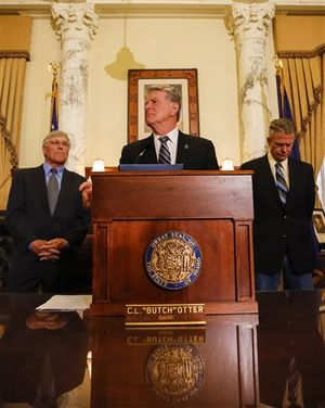 """Idaho Gov. C.L. """"Butch"""" Otter takes questions after issuing a proclamation ordering a special session of the state legislature at the state Capitol building on Wednesday, April 29, 2015 in Boise, Idaho. Present were Director of Health and Welfare Dick Armstrong, left, and Lt. Gov. Brad Little, right. (AP / Otto Kitsinger)"""