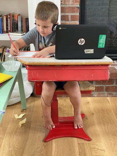 Hyrum Ditto works hard during online kindergarten.  (Julia Ditto/For The Spokesman-Review)
