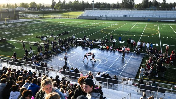 Wrestlers from Mead and Mt Spokane took to the mat during the first ever GSL outdoor wrestling meet at Union Stadium on Thursday.  (Kathy Plonka/The Spokesman-Review)