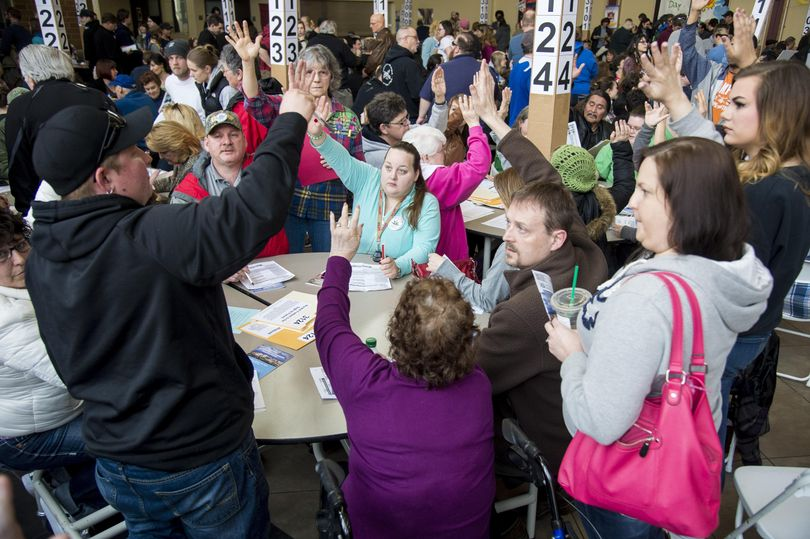 During the Democratic Precinct Caucuses, Precinct 3124 has a show of hands for who supports presidential candidate Bernie Sanders, on Saturday, March 26, 2016, at Rogers High School. (Colin Mulvany / The Spokesman-Review)