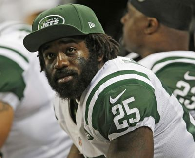 The New York Jets' Joe McKnight sits on the sideline during the fourth quarter of an NFL game against the St. Louis Rams on Nov. 18, 2012 in St. Louis. (Tom Gannam / Associated Press)