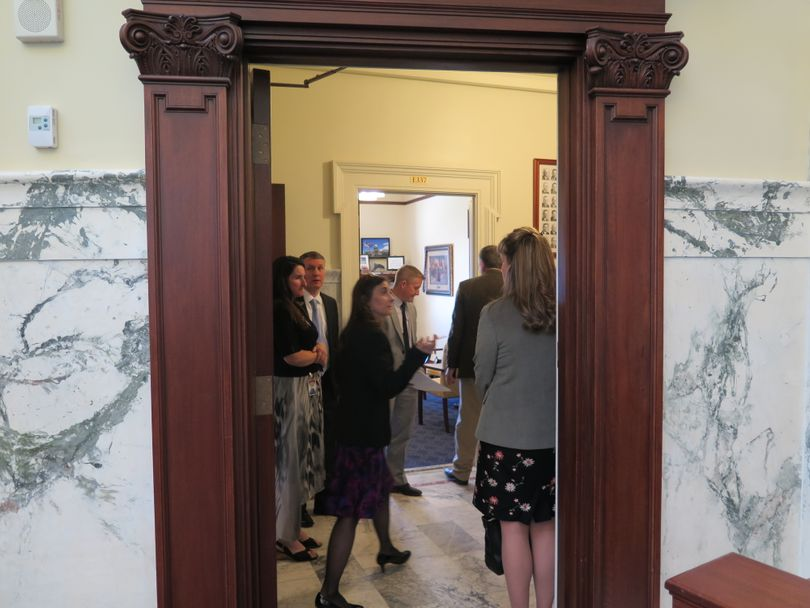 Reps. Heather Scott, R-Blanchard, and Priscilla Giddings, R-White Bird, huddle with House leadership on Thursday over a bill-reading question (Betsy Z. Russell)