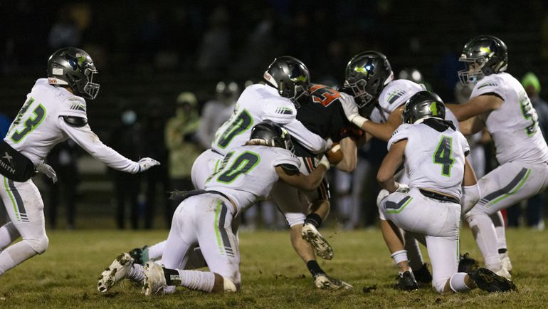 Post Falls senior Tommy Hauser, who had 18 catches for 182 yards, is tackled by a swarm of Mountain View defenders during Friday's 5A State game in Post Falls.  (Cheryl Nichols/For The Spokesman-Review)