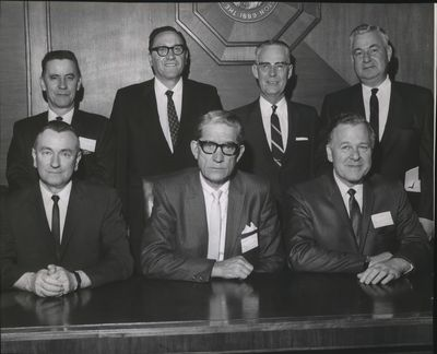 Justice Walter T. McGovern, bottom left, served on the Washington State Supreme Court before being appointed to the federal bench in 1971. He's seated next to fellow state high court judges Chief Justice Robert C. Finley and Justice Marshall A. Neill. In back are, from left: Justice Orris L. Hamilton, Justice Hugh J. Rosellini, Justice Robert Hunter and Justice Frank Hale. Absent were Justice Frank P. Weaver and Justice Richard B. Ott.  (Cowles Publishing)