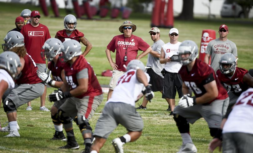 WSU head coach Mike Leach watches his team during practice on Saturday in Lewiston. (Tyler Tjomsland / The Spokesman-Review)