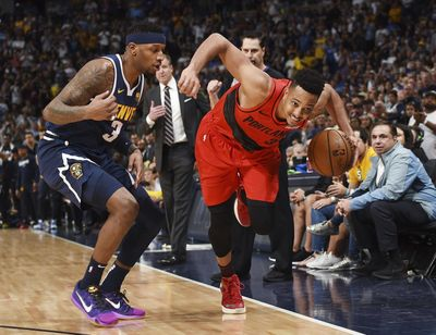 Portland Trail Blazers guard CJ McCollum, right, drives past Denver Nuggets forward Torrey Craig in the second half of Game 7 of an NBA second-round playoff series Sunday, May 12, 2019, in Denver. The Trail Blazers won 100-96. (John Leyba / AP)