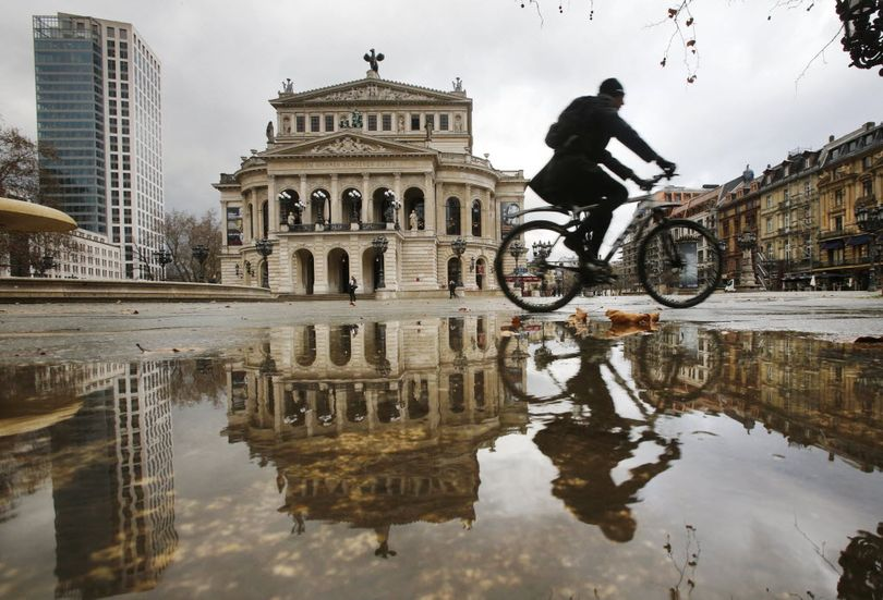 A man on a bicycle passes by the Old Opera that is reflected in a puddle on a rainy day in Frankfurt, Germany, Jan. 13, 2016. If he were in Missouri, he might need a really tall orange flag.  (AP Photo/Michael Probst)