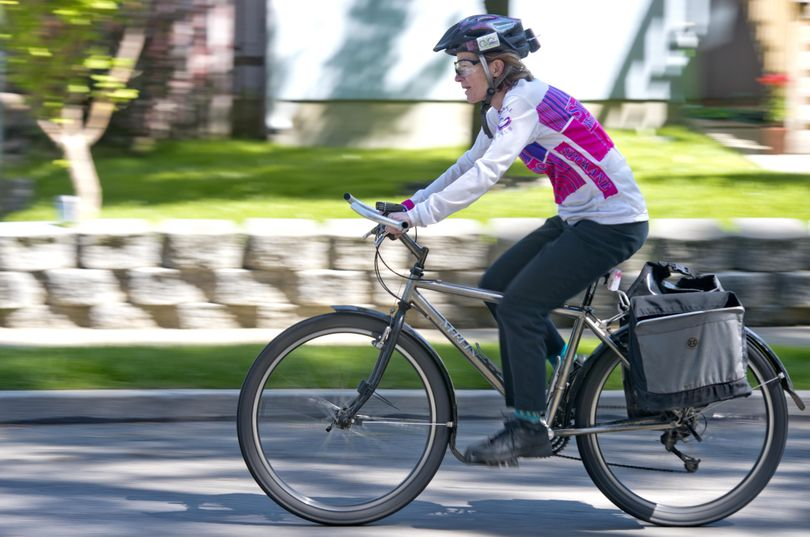 Sally Phillips, shown cycling through her neighborhood, is an avid cyclist and member of the Spokane Bicycle Club and chaired  this year's Bike to Work Week. She was photographed Friday, May 13, 2016. (Jesse Tinsley / The Spokesman-Review)