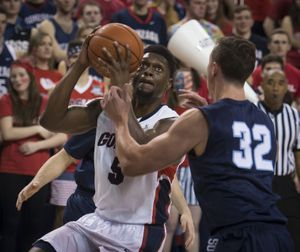 Gonzaga guard Gary Bell Jr. (5) lines up a shot as San Diego forward Brett Bailey (32) defends in the first half of an NCAA men's college basketball game, Thursday, Feb. 26, 2015, in the McCarthey Athletic Center. (Colin Mulvany / The Spokesman-Review)