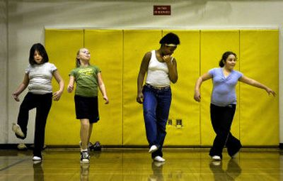 From left, Olivia Thornblade, 10, Jordyn Utter, 11, Onjole Jackson, 10, and Asia Salazar, 10, practice their moves at Regal Elementary School.  (The Spokesman-Review)