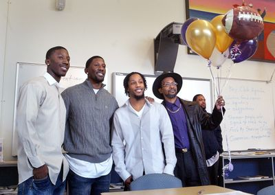 Washington recruit Desmond Trufant of Tacoma, left, poses with (left to right) brothers Marcus and Isaiah, and father Lloyd.  (Associated Press / The Spokesman-Review)