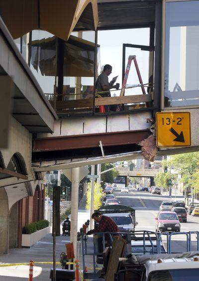 A piece of the skywalk over Howard Street was damaged Thursday.  (Dan Pelle / The Spokesman-Review)