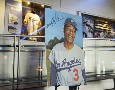 A portrait of baseball great Willie Davis is seen at a memorial service for him at Dodger Stadium.  (Associated Press)