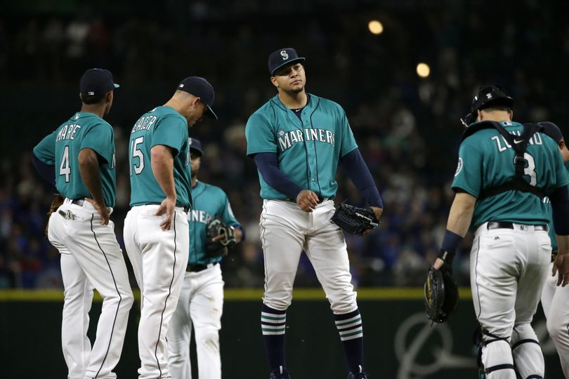 Mariners starting pitcher Taijuan Walker, center, waits on the mound for manager Scott Servais to pull him from a game against the Toronto Blue Jays in the sixth inning, Monday, Sept. 19, 2016, in Seattle. (Ted S. Warren / Associated Press)