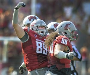 WSU defensive end Travis Long (89) celebrates with teammate Kalafitoni Pole( 98) after they combined to sack the UNLV quarteback during their game at Martin Stadium in Pullman, Saturday, Sept. 10, 2011. (Christopher Anderson / Spokesman-Review)
