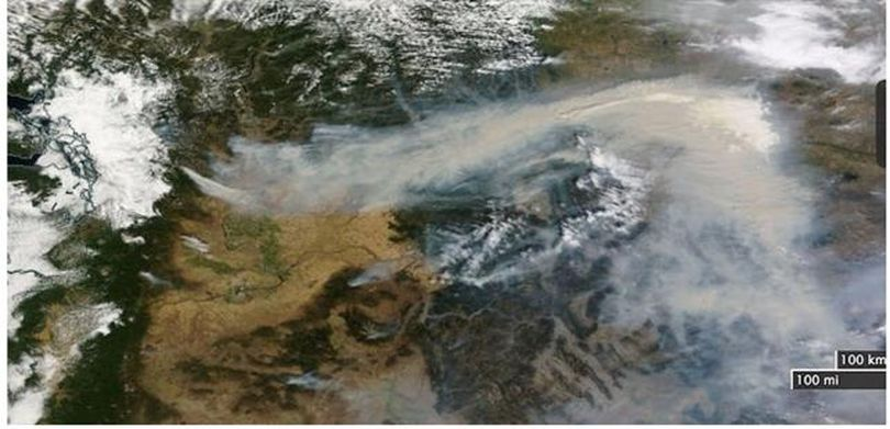 Spokane is in the center of this satellite image wildfire smoke across Pacific Northwest on Aug. 20, 2015.  Origin point of smoke on the left is the 42,000-acre Wolverine Fire in the Glacier Peak Wilderness area near upper Lake Chelan.  Farther east, the 134,000-acre Chelan, 162,000-acre Okanogan, 110,000-acre Colville Indian Reservation, and 90,000-acre Colville area fires all merge and drift east across Montana and into the Midwest. (NOAA)