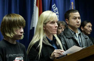 Family members of murdered Bobbie Jo Stinnett, from left, brother Tyler Harper, mother Becky Harper, and husband Zeb Stinnett, speak to the press Friday after jurors in the trial of Lisa Montgomery, Bobbie Jo Stinnett's killer,  recommended the death sentence. Associated Press  (Associated Press / The Spokesman-Review)