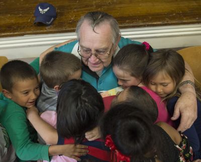 """Jackie Dayley or better known as """"Grandpa Jack"""" receives hugs by dozens of students after an assembly Friday, Sept. 14, 2018, at Lincoln Elementary School in Twin Falls. Dayley has been volunteering his time to the school for about 18 years. (Drew Nash / (Twin Falls) Times-News)"""