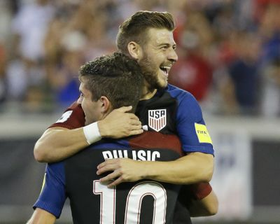 United States' Paul Arriola, right, celebrates with Christian Pulisic. (John Raoux / Associated Press)