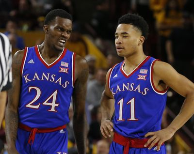 Kansas guard Lagerald Vick (24) and Devon Dotson  react during the first half  of Saturday's loss against Arizona State  in Tempe, Ariz. (Rick Scuteri / AP)