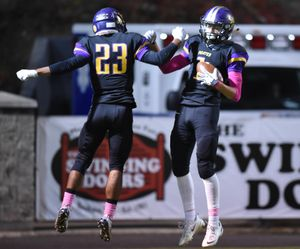 Rogers' Khalil Winfrey, right, celebrates his first touchdown against North Central with teammate Marcus Phillips, left, Friday, Oct. 30, 2015, at Joe Albi Stadium. (Jesse Tinsley / The Spokesman-Review)