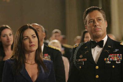 This 2006 photo shows Kim Delaney, left, and Brian McNamara, who plays her husband, attending the Military Ball in the first episode of the new Lifetime original series