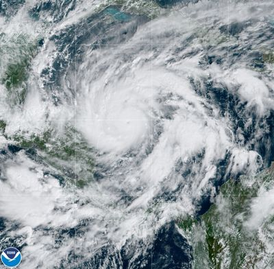 This GeoColor satellite image taken Monday, Nov. 2, 2020, at 1 p.m. EDT, and provided by NOAA, shows Hurricane Eta in the Gulf of Mexico approaching the border of Honduras and Nicaragua. New Hurricane Eta quickly gained force Monday as it headed for Central America on the verge of becoming a major hurricane, threatening massive flooding and landslides across a vulnerable region.  (HOGP)