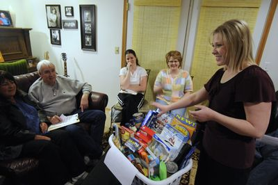 At a workshop on coupon strategies, Tianna Abel, far right, an educator for BeCentsAble.net, displays a basket of $106 worth of groceries she got for only $4.  (Colin Mulvany / The Spokesman-Review)