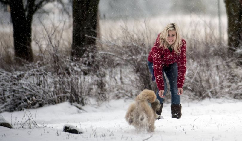 Miri Halliday of Post Falls, plays with her dog, Dozer at the SCRAPS Dog Park in Stateline on Monday. (Kathy Plonka / The Spokesman-Review)