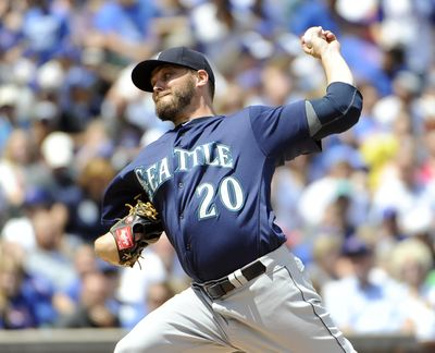 Wade Miley throws for the Mariners against the Chicago Cubs on Saturday, July 30. He was dealt to the Orioles for a minor leaguer on Sunday. (Associated Press)
