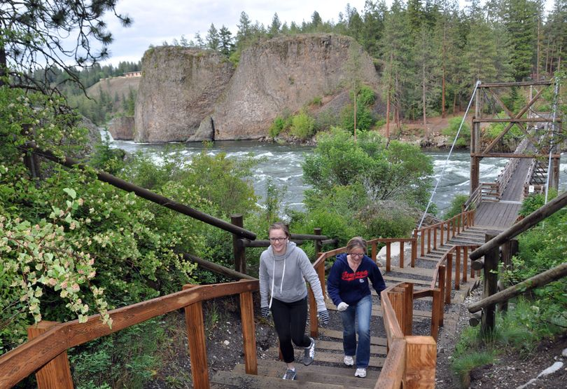 Riverside State Park visitors take advantage of the new steps leading up from the Bowl and Pitcher footbridge over the Spokane River. (Rich Landers)