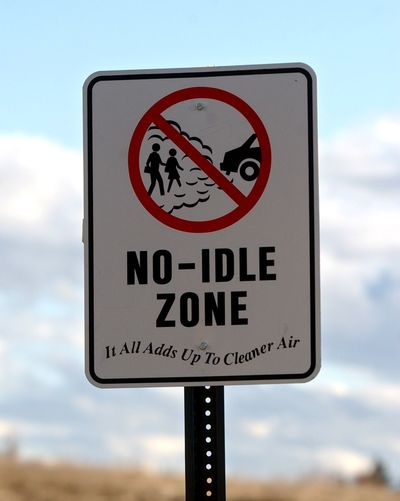 No-idle zone signs were put up in the Pasadena Elementary School parking lot to remind drivers to turn off their vehicles if they're waiting for more than 30 seconds.  (LIZ KISHIMOTO/The Spokesman-Review)