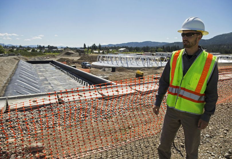 John Beacham speaks with the Press, Friday, about water reclamation facility upgrades including two flow equalization tanks, a solids storage hopper and a biofilter, seen left, to control odor. (Loren Benoit/Coeur d'Alene Press photo)