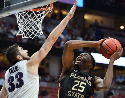 Gonzaga's Killian Tillie contests a shot by Florida State's Mfiondu Kabengele during a 2019 NCAA Tournament game. (Tyler Tjomsland / The Spokesman-Review)