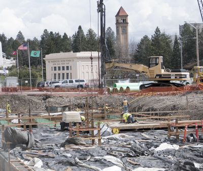 FILE – Workmen finish the giant stormwater storage tank at Monroe Street and Bridge Avenue April 10. The lot had been proposed as a location for a new climbing gym, but city officials are backing away from that proposal after staunch opposition. (Jesse Tinsley / The Spokesman-Review)