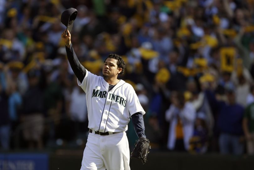 Felix Hernandez tips his cap to the crowd as he leaves during the sixth inning with the A.L. ERA title but without a postseason berth. (Associated Press)