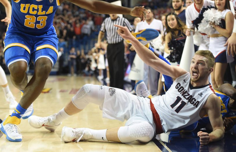 Gonzaga's Domantas Sabonis points at UCLA's Tony Parker, left, after chasing a loose ball to the sidelines in the second half Saturday, Dec. 12, 2015 at McCarthey Athletic Center. The call went Sabonis' way, but the UCLA Bruins edged the Zags 71-66. (Jesse Tinsley / The Spokesman-Review)