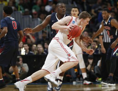 Utah forward Jakob Poeltl, front, drives past Fresno State center Terrell Carter II in the second half of a first-round men's college basketball game Thursday, March 17, 2016, in the NCAA Tournament in Denver. Utah won 80-69. (David Zalubowski / Associated Press)