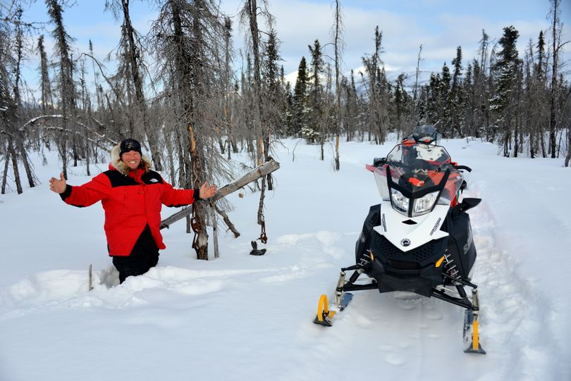Josh Rindal poses by a marten set in deep snow along the Iditarod Trail on the Kaltag Portage between Kaltag and Unalakleet. Rindal and Bob Jones of Kettle Falls were snowmobiling 1,400-miles along the route of Alaska's famous Iditarod Sled Dog Race in March 2014. (Robert Jones)