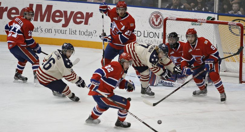 Spokane Chiefs break up a Tri-City Americans attack on Saturday during the second game of Game 2 of the teams' WHL Western Conference playoff series at the Toyota Center in Kennewick. (Kai-Huei Yau / Tri-City Herald)