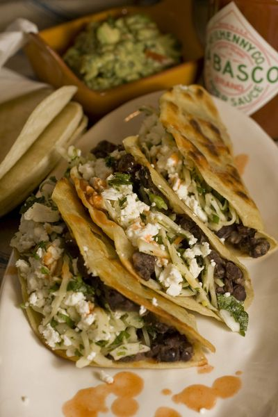 Crispy Black Bean Tacos with Feta and Cabbage Slaw  made at home are every bit as tasty as take-out tacos.  (Associated Press / The Spokesman-Review)