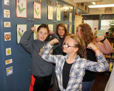 Brooklyn Bailey, left, and Madyson Doolittle-Brown doing some of the welcome exercises in their fifth-grade classroom at West Intermediate School in Sutherlin, Ore. on May 11. Their fifth-grade class is just one of the classes in Sutherlin that uses a program called Conscious Discipline Building Resilient Children. Exercises and music are used to get students focused and excited about the day. (Dan Bain / AP)