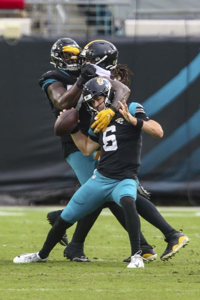 Pittsburgh Steelers linebacker Bud Dupree (48) pushes past Jacksonville Jaguars offensive tackle Cam Robinson (74), left, to sack quarterback Jake Luton (6) during the second half of an NFL football game, Sunday, Nov. 22, 2020, in Jacksonville, Fla. (AP Photo/Gary McCullough) ORG XMIT: NYOTK  (Gary McCullough)
