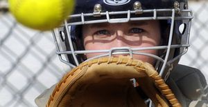 Lake City High School senior Jessica Ross has taken the reins behind the plate and leads the team in several batting categories.   (Kathy Plonka / The Spokesman-Review)