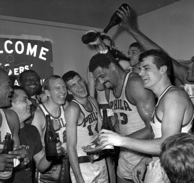 Wilt Chamberlain gets champagne poured on him as the 76ers celebrate winning the Eastern Division championship in 1967. (Associated Press)