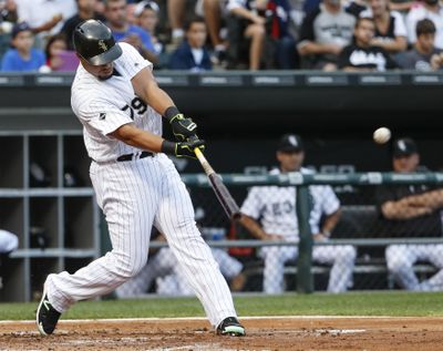 Jose Abreu of the Chicago White Sox hits a home run off Seattle's Ariel Miranda during the first inning Saturday in Chicago. (Kamil Krzaczynski / Associated Press)